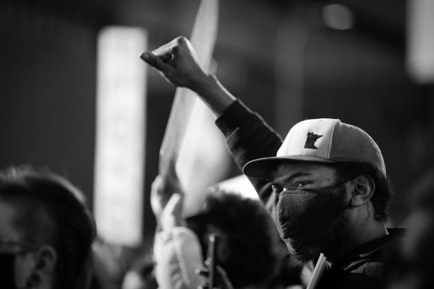 Man in Minnesota raises his fist at a protest