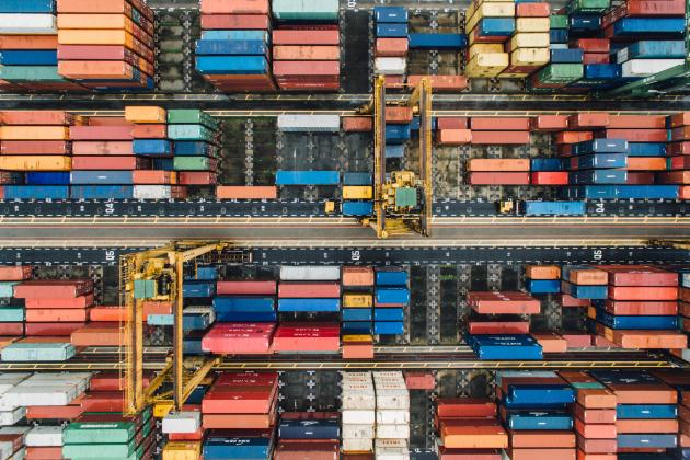 Overhead photo of large port and containers stored there